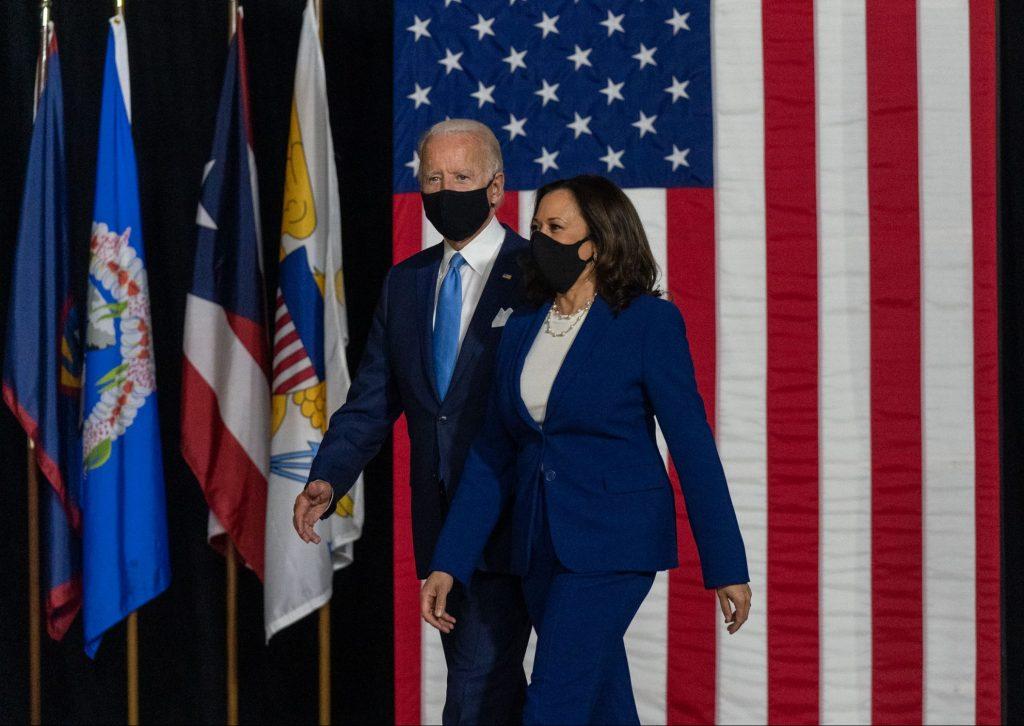 President Joe Biden and Kamala Harris walk onstage