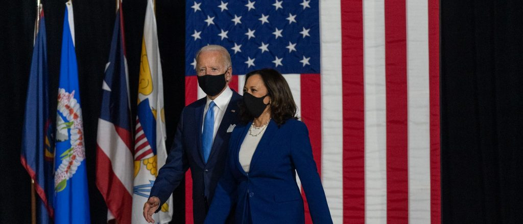 President Joe Biden and Kamala Harris walk onstage
