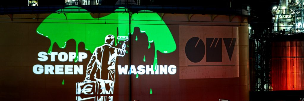 Stop Greenwashing protest projection